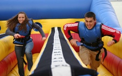 Boy and Girl Competing on the Bungee Run Course at a party in McDonough, Georgia