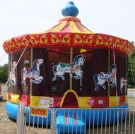 Carousel Bounce House with horses and inflatable in McDonough GA